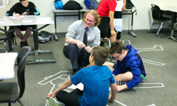 Teacher of the Year Alexander MacKenzie working with kids