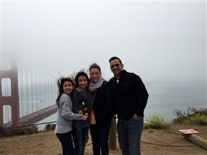 Picture of Mrs. Gonzalez with her family at the Golden Gate Bridge in San Francisco