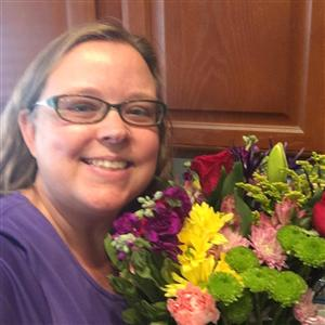 me with a bouquet of flowers from a student.