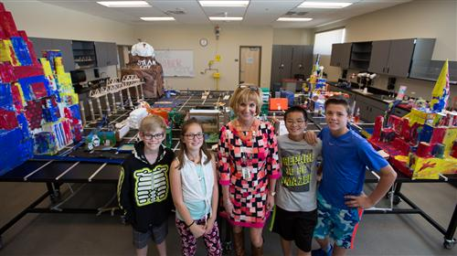 Mrs. Richards with CSO's in front of recycled STEM CITY