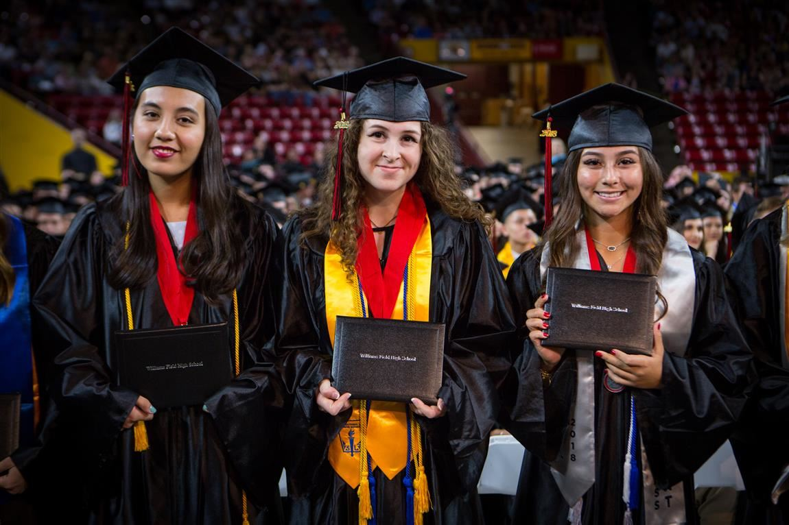Williams Field High School students holding diplomas