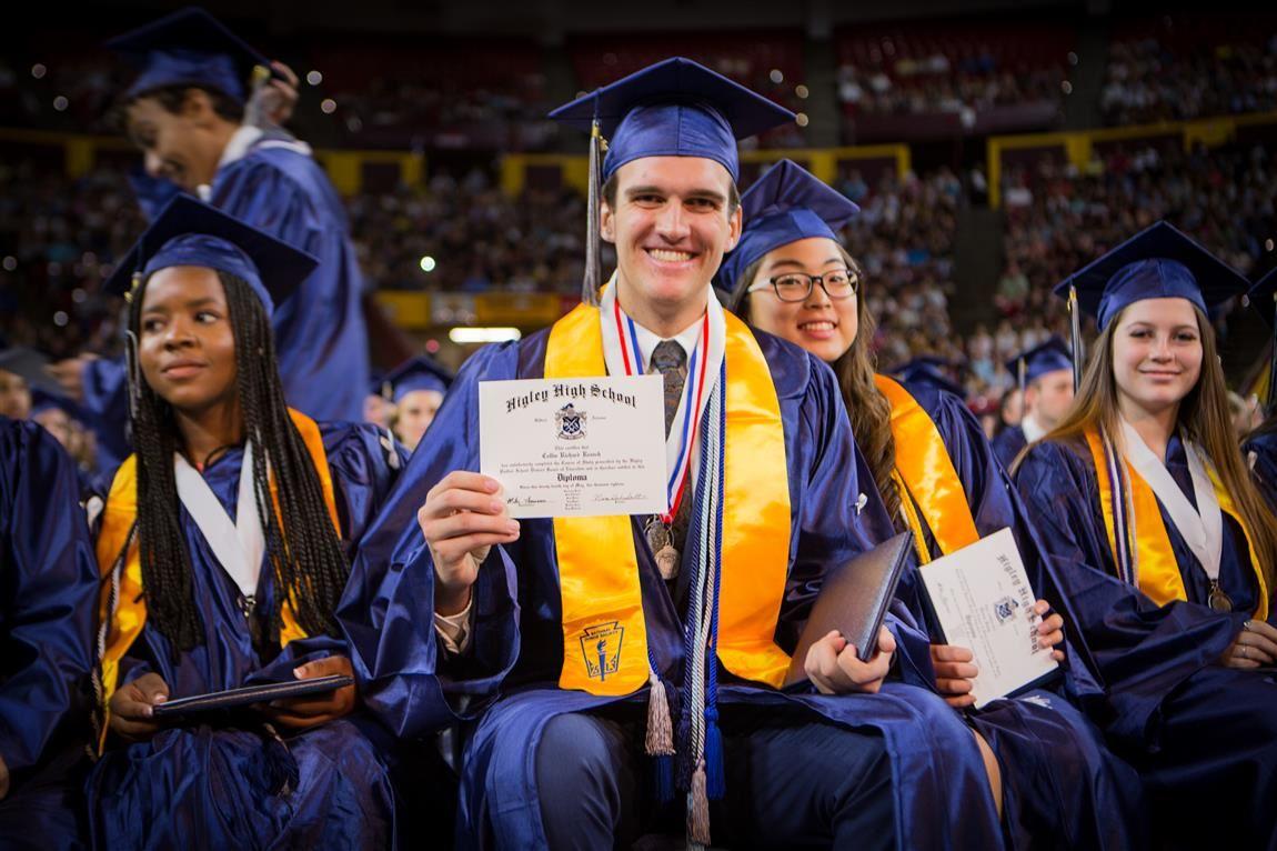 Higley High School students holding diplomas