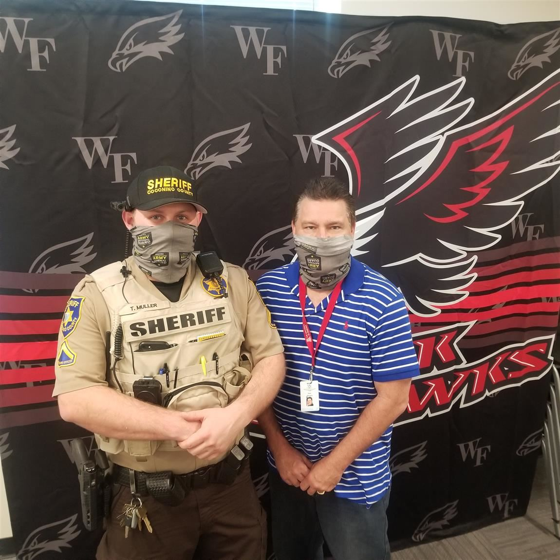 Tyler Muller in uniform and Mr. Williams standing together at Williams Field High School