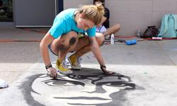Student Creating Chalk Mural