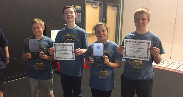 SMS students holding award certificates