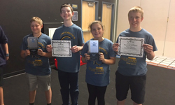 SMS students holding their award certificates